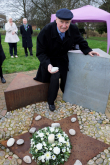 Deputy Mayor Cllr Brian Parker Laying a stone at the Memorial